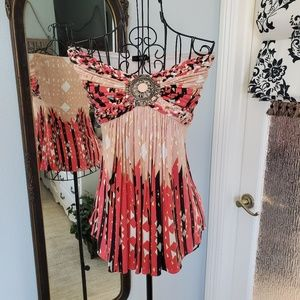 Sky strapless top with metal medallion